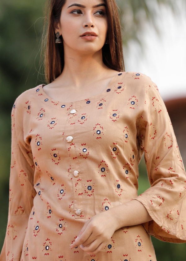 Light beige colour kurti and sharara