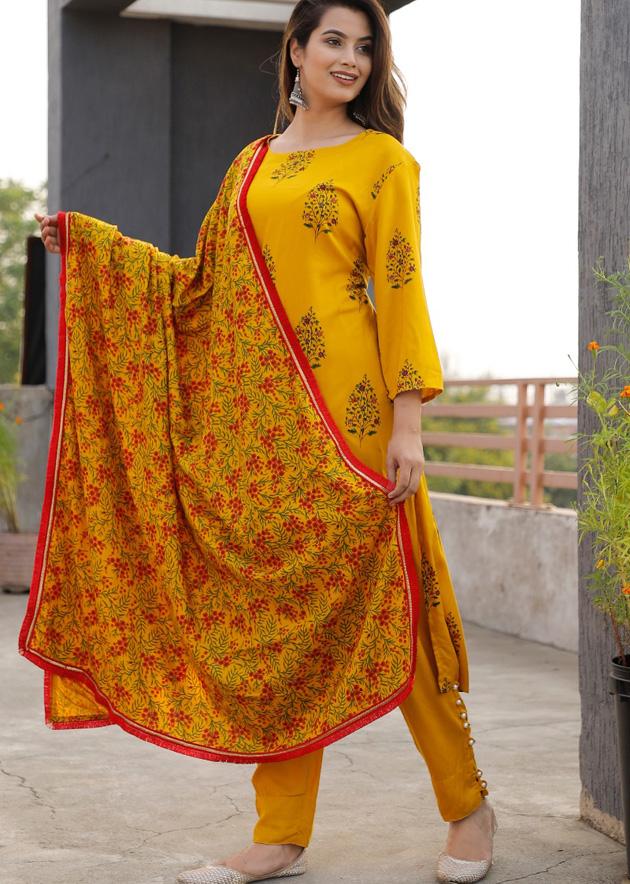 Yellow kurti, pant and dupatta